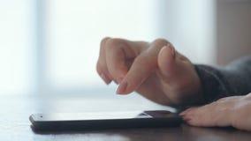 Woman using smart phone. Women`s hands using smart phone stock video footage