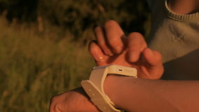 Woman using smart watch in forest at sunset stock video footage