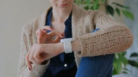 Woman using smart watch at home. Entertainment and technology concept stock footage