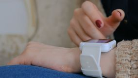 Woman using smart watch at home. Entertainment and technology concept stock video footage