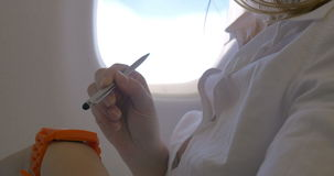 Woman using smart watch in plane stock footage