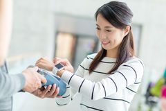 Woman using smart watch to pay on pos terminal. Young Woman using smart watch to pay on pos terminal Stock Images