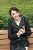Woman using smartphone Stock Images