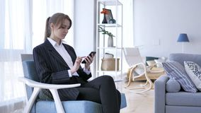 Woman Using Smartphone, Browsing online at Work royalty free stock images