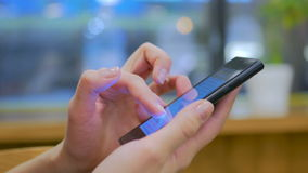 Woman using smartphone in cafe. Close-up shot of woman hands with smartphone in cafe. Technology concept stock video