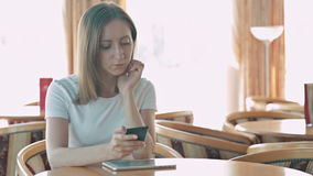 Woman using smartphone in cafe. In cafe on cruise ship stock video footage