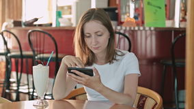 Woman using smartphone in cafe. In cafe on cruise ship stock video