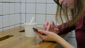 Woman using smartphone in cafe. Technology concept stock video footage