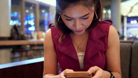 Woman using smartphone in cafe