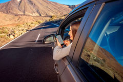 Woman using smartphone in the car Royalty Free Stock Images