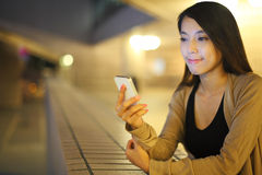 Woman using smartphone in city stock photo
