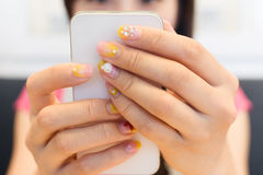 Woman using smartphone Royalty Free Stock Image