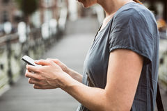 Woman Using a Smartphone Royalty Free Stock Image