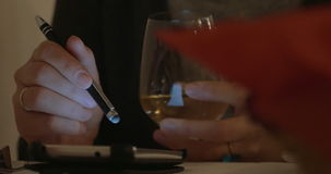 Woman Using Smartphone and Drinking Wine stock video