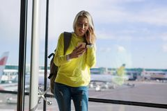 Woman using smartphone in airport Stock Photos