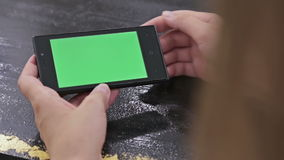 Woman using smartphone with green screen. Close up shot of woman's hands with mobile. Various hand gestures - scrolling and touching stock video