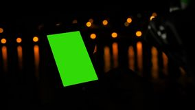 Woman using smartphone with green screen on deck of cruise ship at night. Woman using vertical smart phone with green screen on deck of cruise ship at night stock video