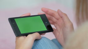Woman using smartphone with green screen. Woman using horizontal smartphone with green screen. Close up shot of woman`s hands with mobile Close up shot of woman` stock video