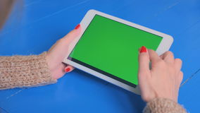 Woman using smartphone with green screen. Woman using vertical smartphone with green screen. Close up shot of woman`s hands with mobile. Technology, chroma and stock video