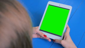 Woman using smartphone with green screen. Woman using vertical smartphone with green screen. Close up shot of woman`s hands with mobile. Technology, chroma and stock video footage