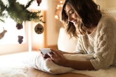 Woman using a smartphone at home royalty free stock photo
