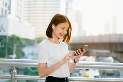 Woman using smartphone, During leisure time. The concept of using the phone is essential in everyday life. stock photos