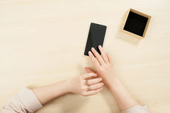 Woman using smartphone, mockup, user pov Royalty Free Stock Image