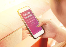 Woman using smartphone with online banking. Stock Images