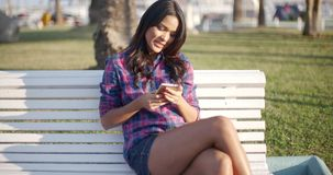 Woman Using Smartphone Outdoors. stock video