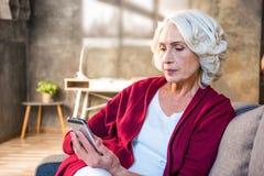 Woman using smartphone Stock Image
