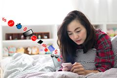 Woman using smartphone for shopping online at home. royalty free stock images