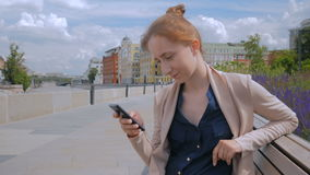 Woman using smartphone stock footage