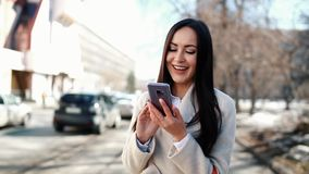 Woman using a smartphone stock footage