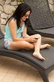 Woman Using Smartphone Stock Photography
