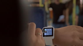 Woman using smartwatch in the bus stock footage