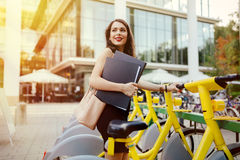 Woman using solar city bike Royalty Free Stock Images