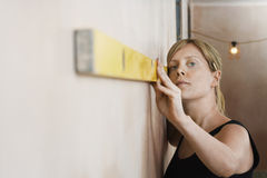 Woman Using Spirit Level Stock Photography