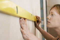 Woman Using Spirit Level Royalty Free Stock Photos