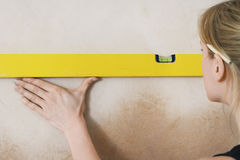 Woman Using Spirit Level Stock Image