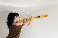 Woman using a spirit level Stock Photos