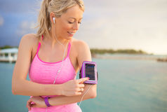 Woman using sports tracking mobile app on her smartphone Royalty Free Stock Image