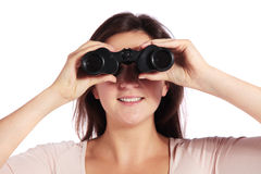 Woman using spyglass Stock Images