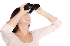 Woman using spyglass Royalty Free Stock Photo