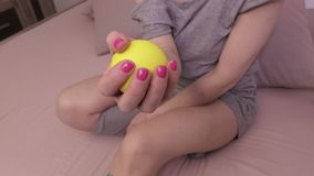 Woman using stress ball stock footage