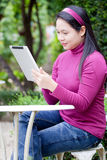 Woman using tablet Royalty Free Stock Image