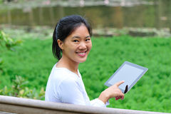 Woman using tablet Stock Photography