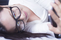 Woman using a tablet at bedroom Royalty Free Stock Image