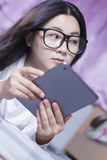 Woman using a tablet at bedroom Stock Images