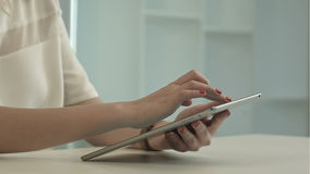 Woman using tablet, browsing internet stock footage