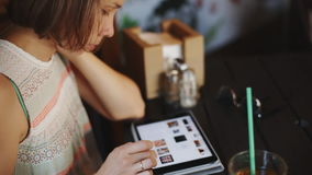 Woman using tablet in cafe stock footage